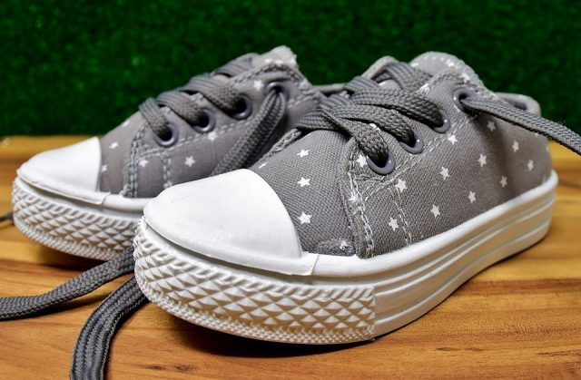 gray canvas shoes with polkadots