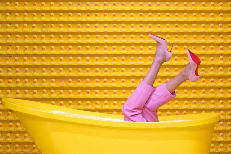 Woman inside a big yellow container