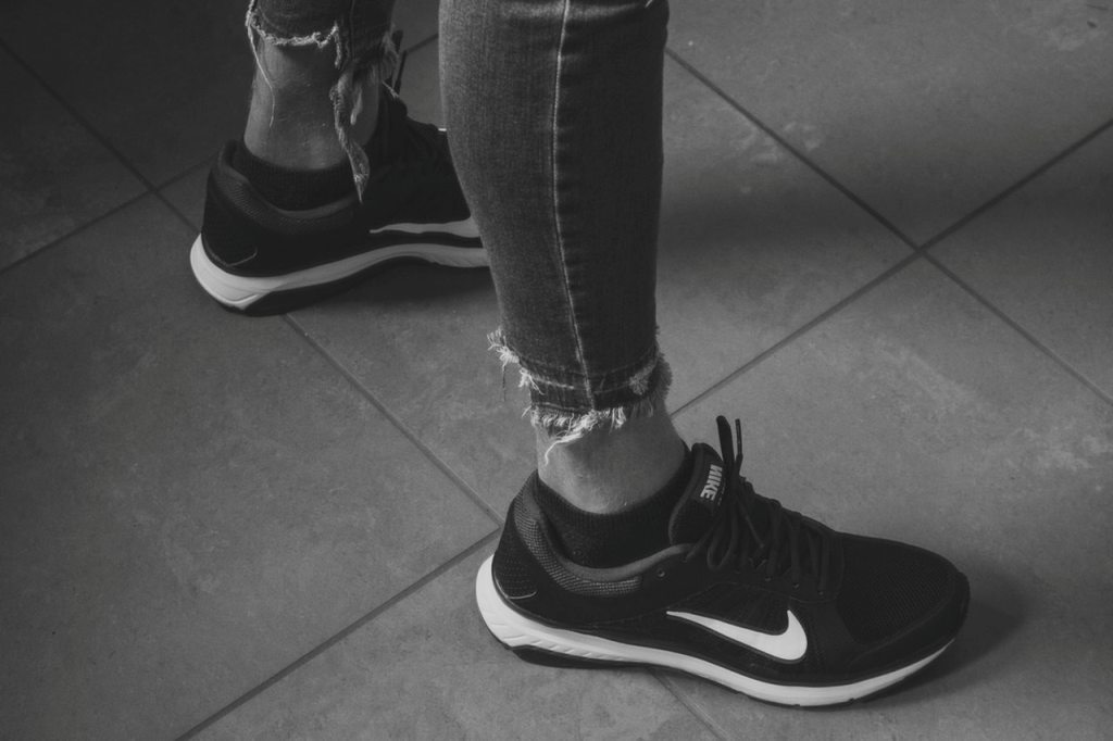 person in black nike running shoes