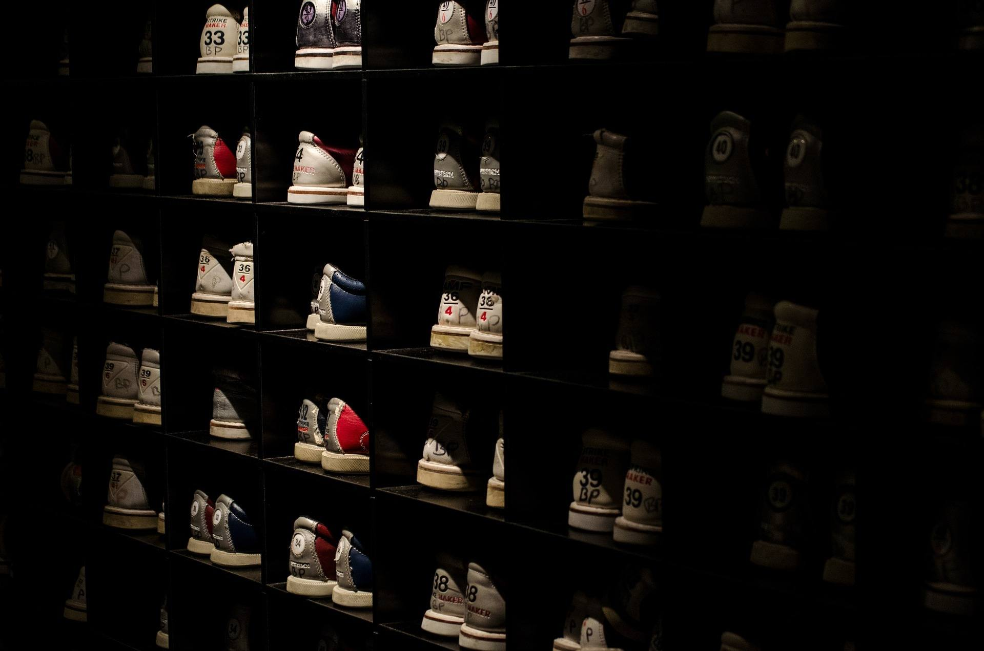 a display of bowling shoes in shoe museums