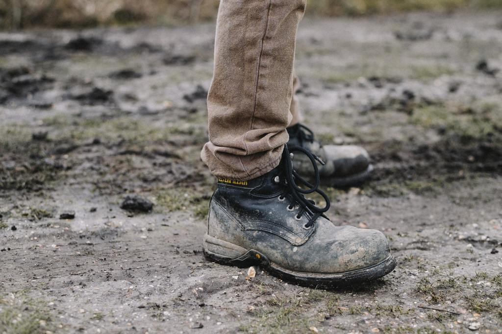 muddy and durable work boots